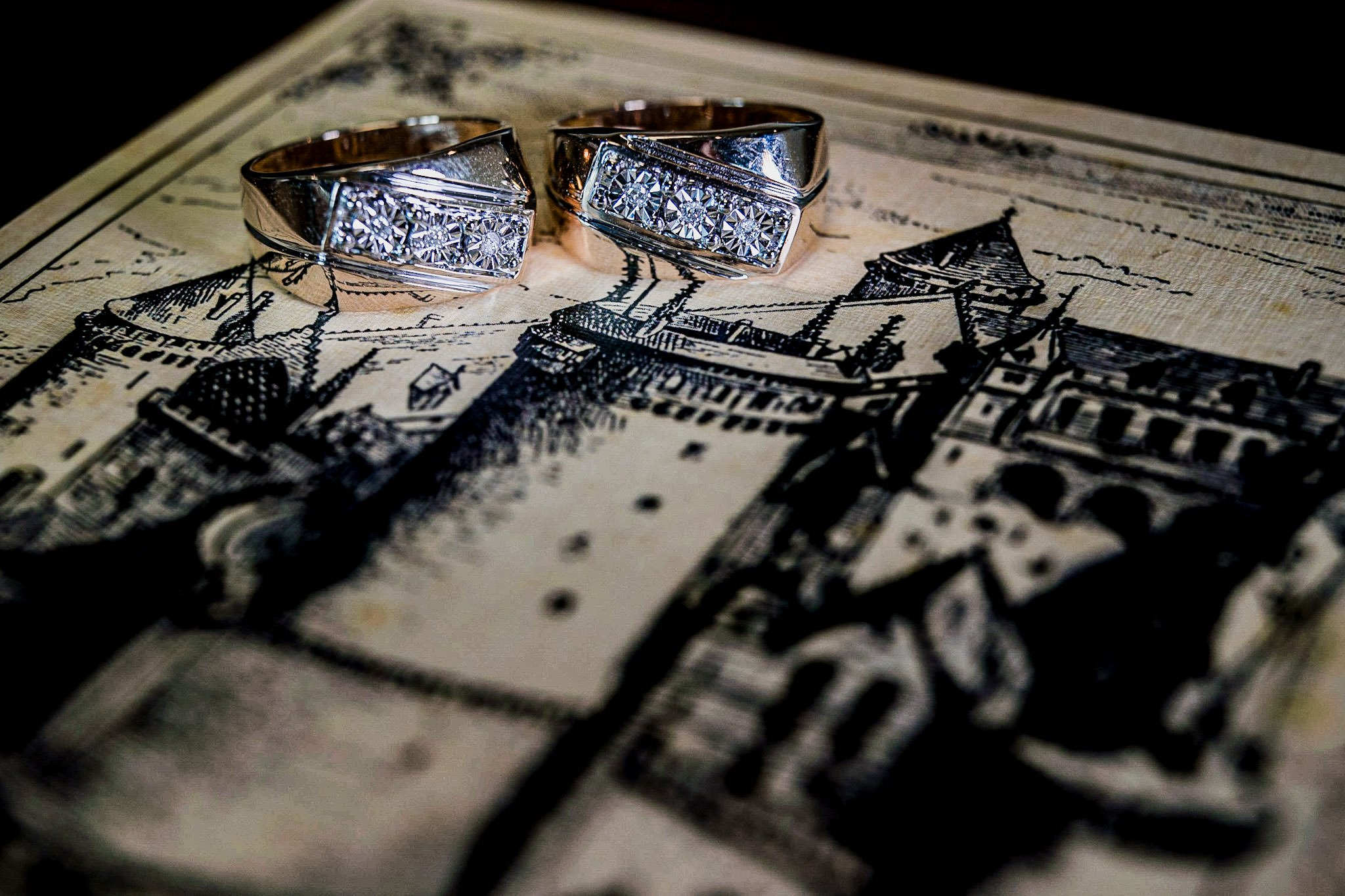 Allerton Castle Knaresborough Hutchinson Weddings Photography the groom and grooms wedding rings on their invite showing a picture of a castle