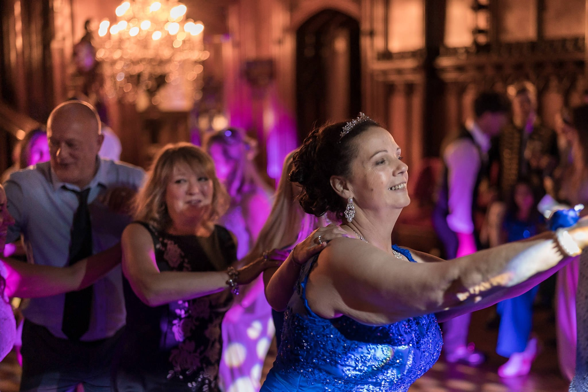 Allerton Castle Knaresborough Hutchinson Weddings Photography wedding guests doing the conga line during the evening fun and festivities