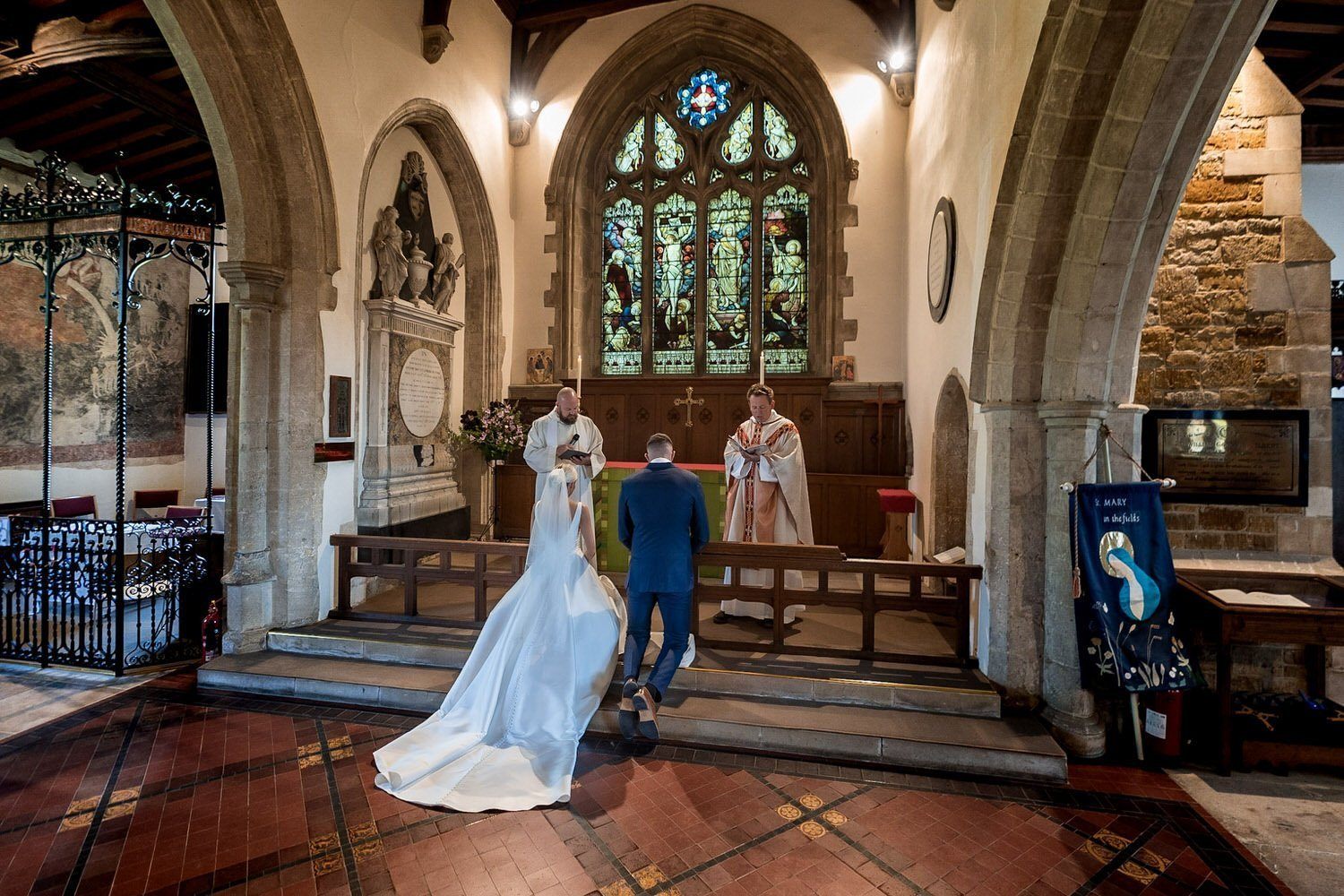 Great Bowden Parish Church Lockwood Weddings Photography bride and groom kneeling at the high altar for their wedding blessing