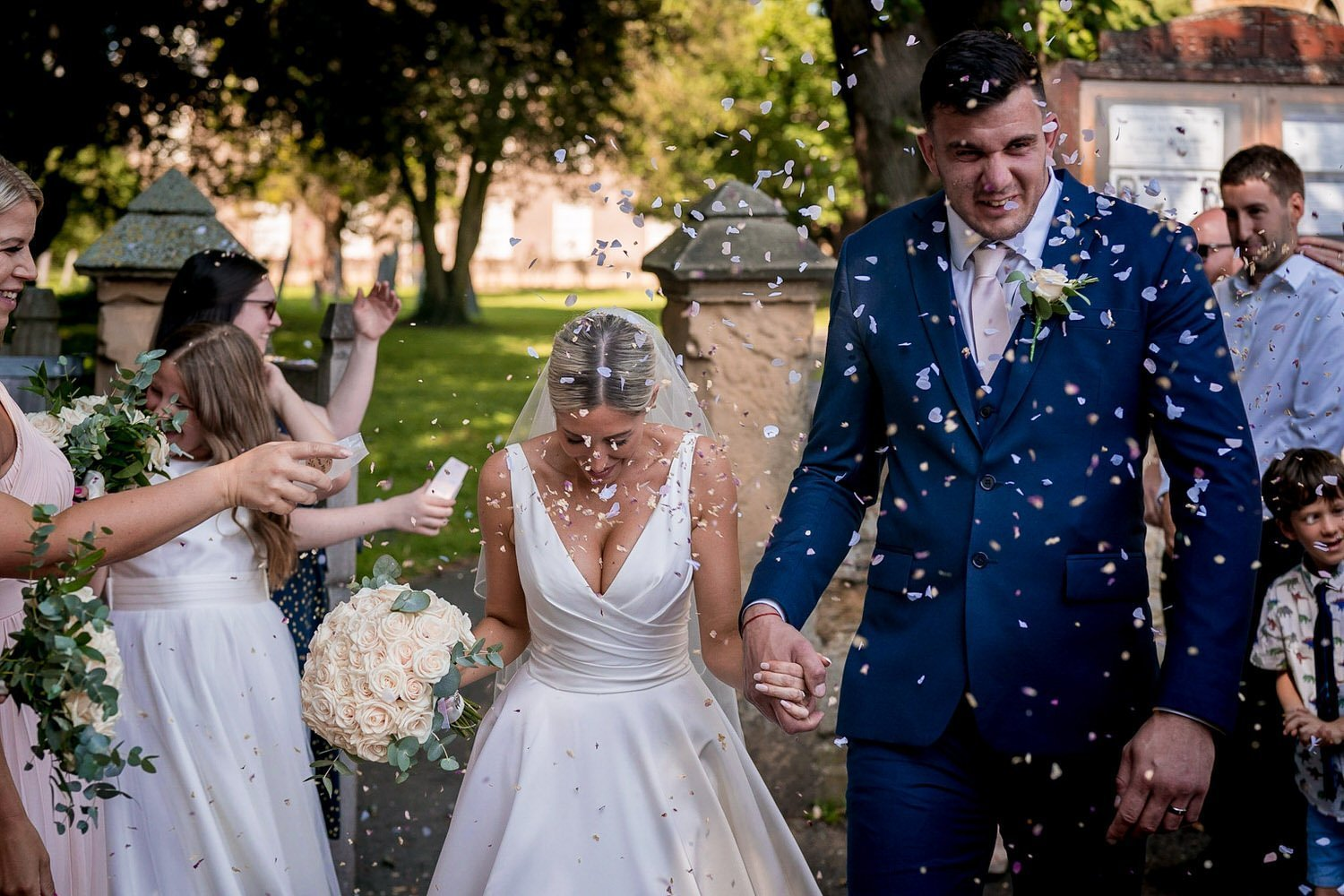 Great Bowden Parish Church Lockwood Weddings Photography bride and groom showered in confetti