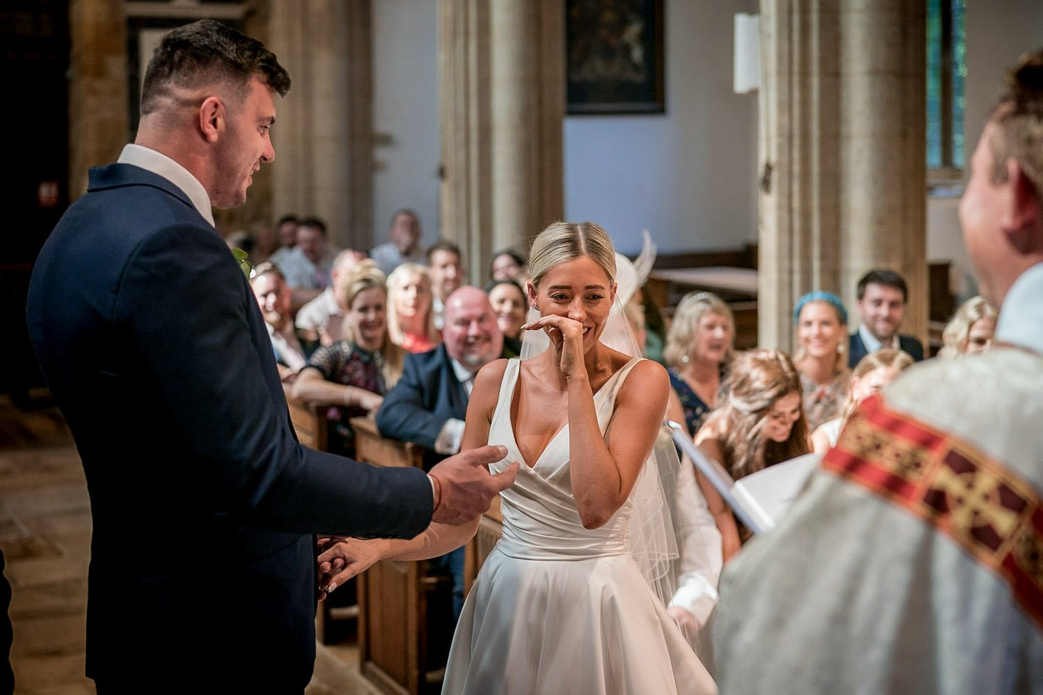 Great Bowden Parish Church Lockwood Weddings Photography bride wiping away a tear and laugh at the same time