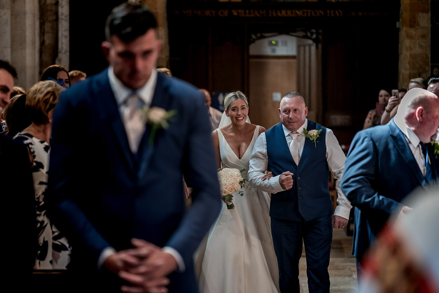 Great Bowden Parish Church Lockwood Weddings Photography groom looking at the floor nervously as his bride arrives down the aisle