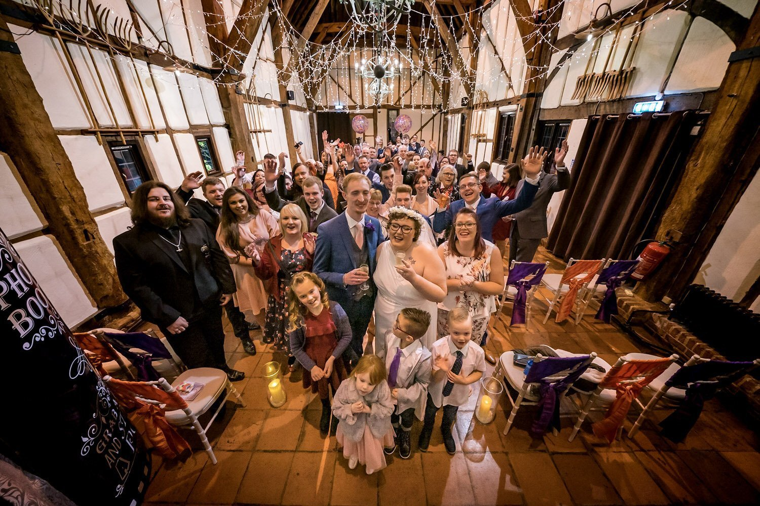 The Barns Hotel Bedford Wooten Weddings Photography All wedding guests in a group photo in the main hall
