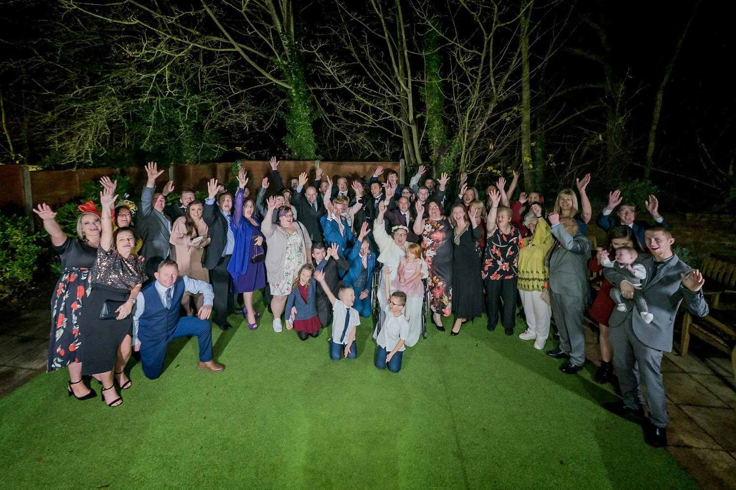The Barns Hotel Bedford Wooten Weddings Photography All wedding guests in a group photo on the side lawn