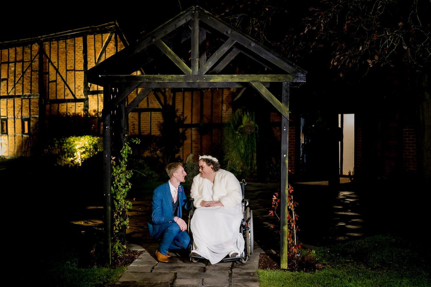 The Barns Hotel Bedford Wooten Weddings Photography Bride and groom during night photos under the wooden archway