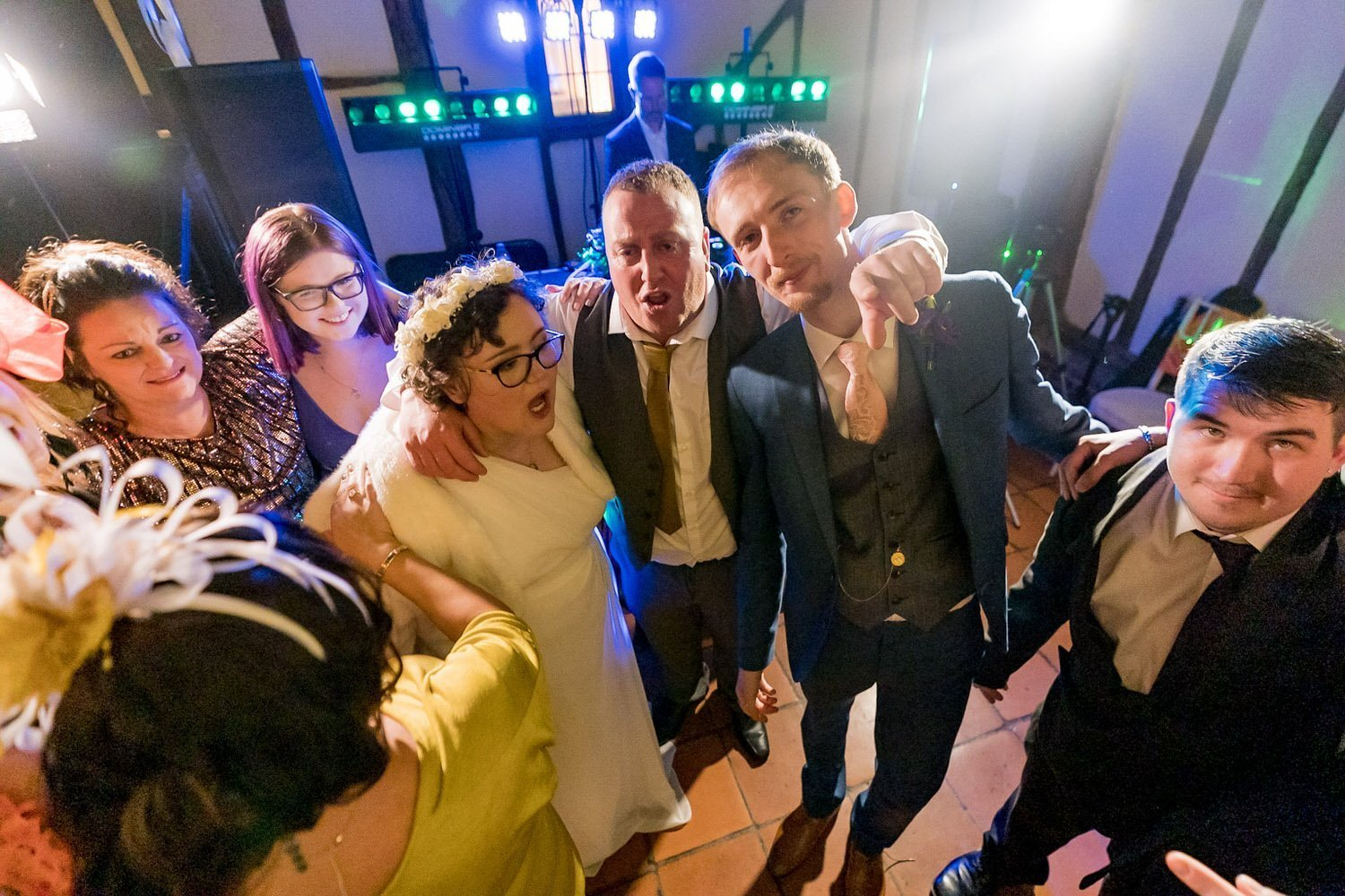 The Barns Hotel Bedford Wooten Weddings Photography Bride and groom on the dancefloor huddled together with their family and friends