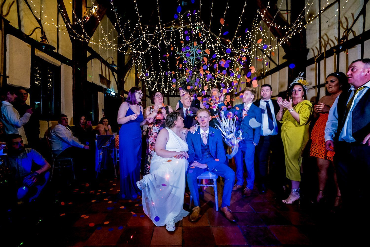 The Barns Hotel Bedford Wooten Weddings Photography Bride and groom on the dancefloor with confetti falling around them