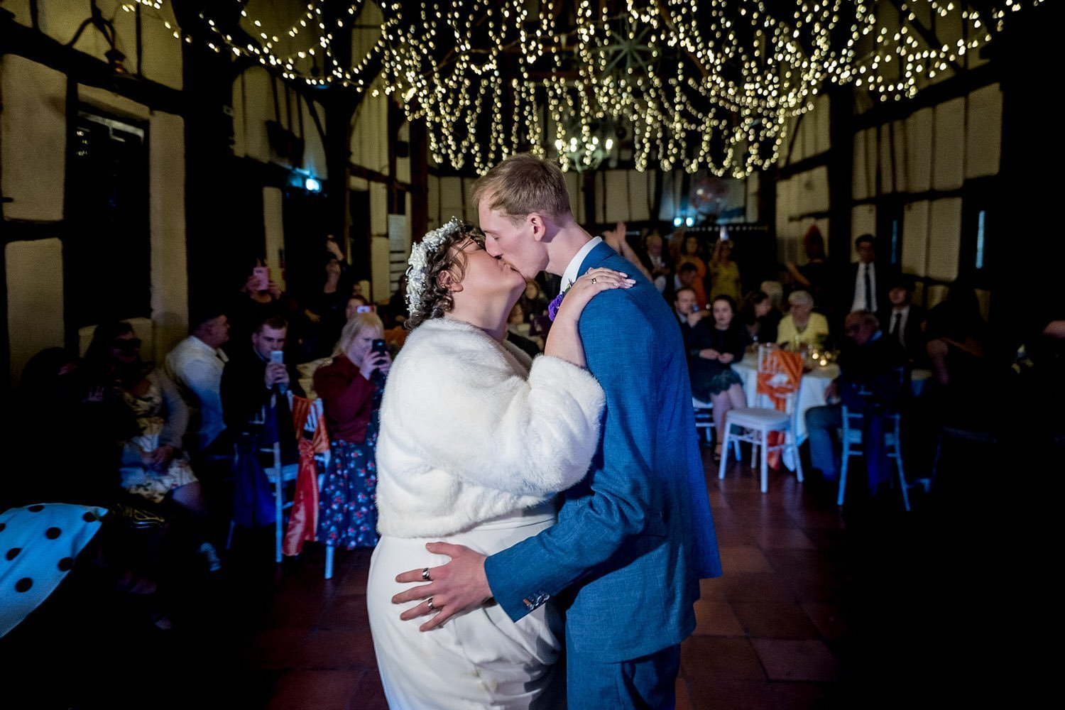 The Barns Hotel Bedford Wooten Weddings Photography Bride and groom sharing a kiss during first dance with the sparkling lights making the beauty