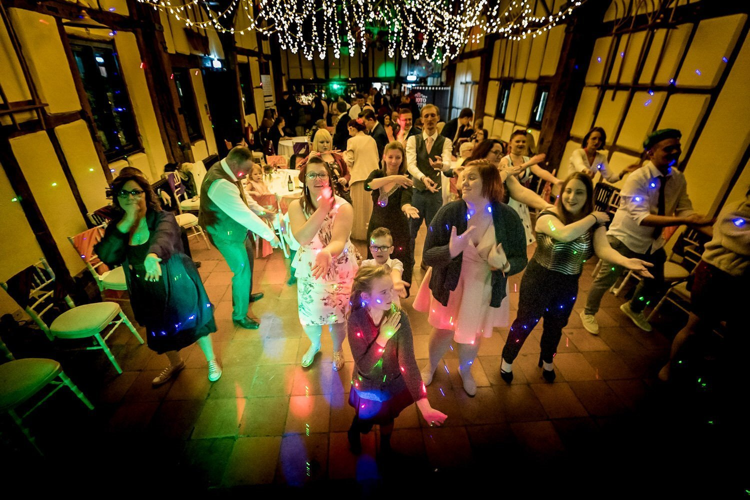 The Barns Hotel Bedford Wooten Weddings Photography Family and friends on the dancefloor doing the macarena