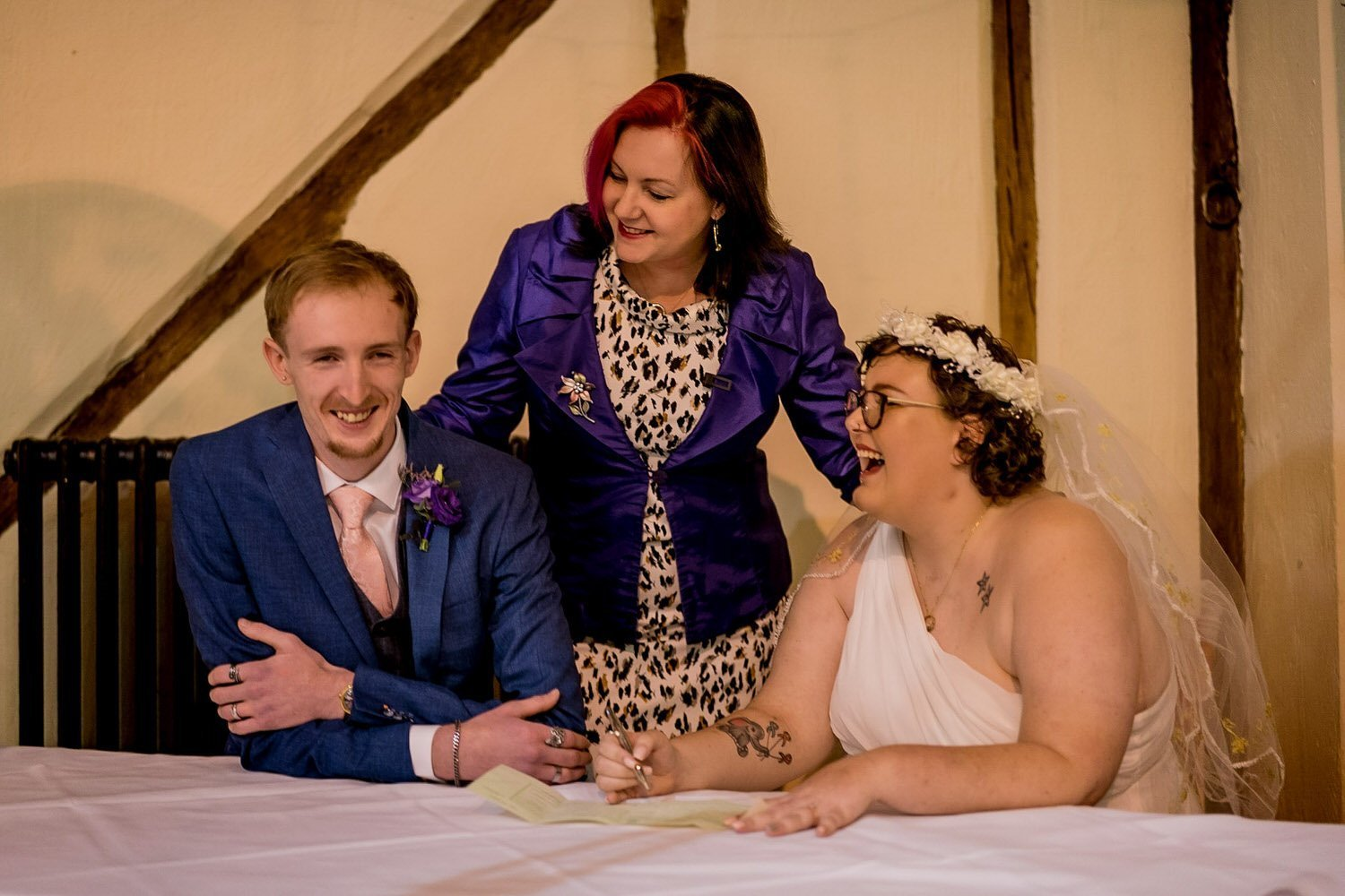 The Barns Hotel Bedford Wooten Weddings Photography Groom bride and celebrant registrar signing of the wedding register
