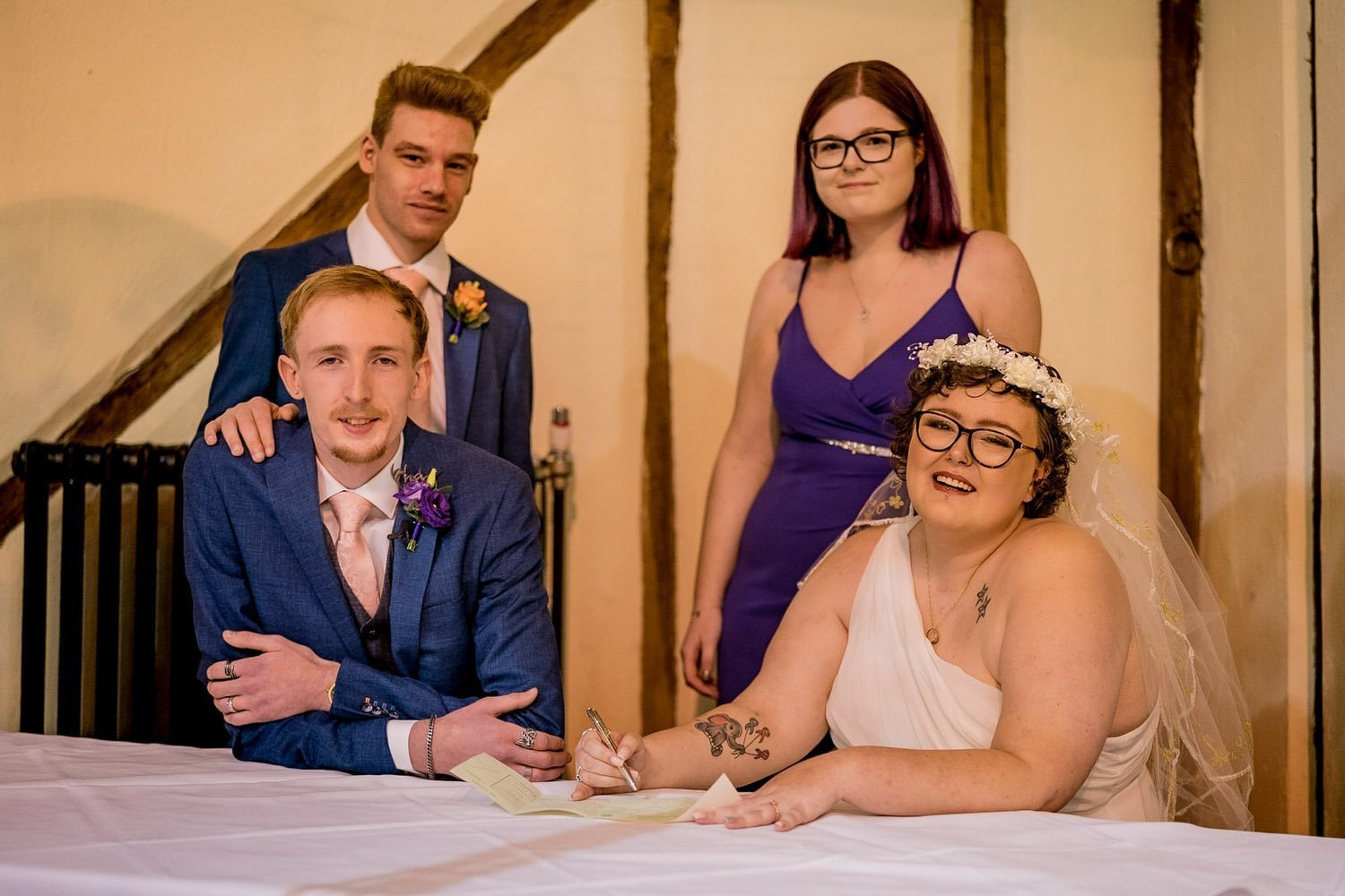 The Barns Hotel Bedford Wooten Weddings Photography Groom bride bestman and maid of honour with the signing of the wedding register