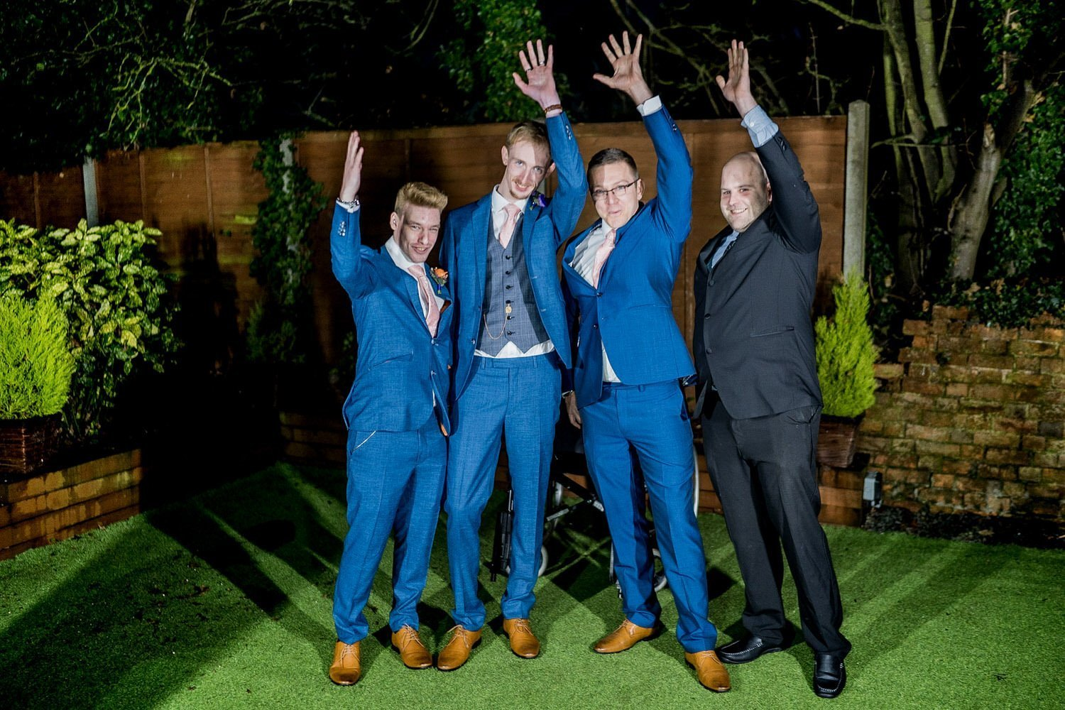 The Barns Hotel Bedford Wooten Weddings Photography groom and ushers throwing their arms up in celebration