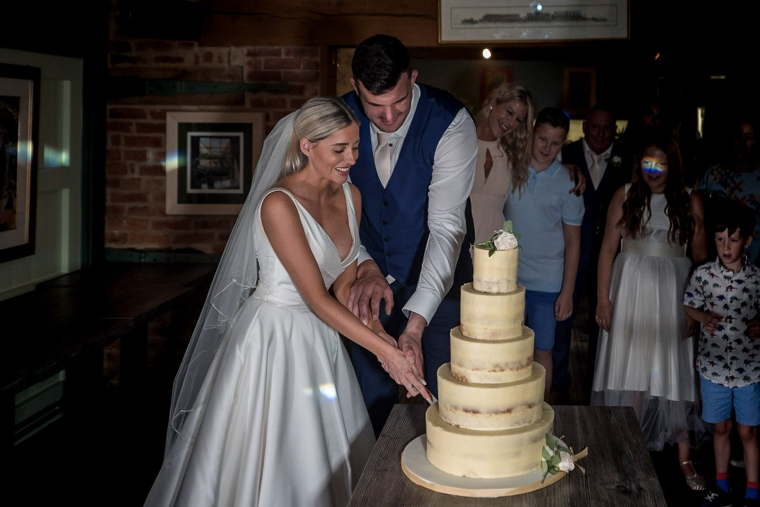 The Waterfront Market Harborough Lockwood Weddings Photography bride and groom cutting the cake together hands together on the knife