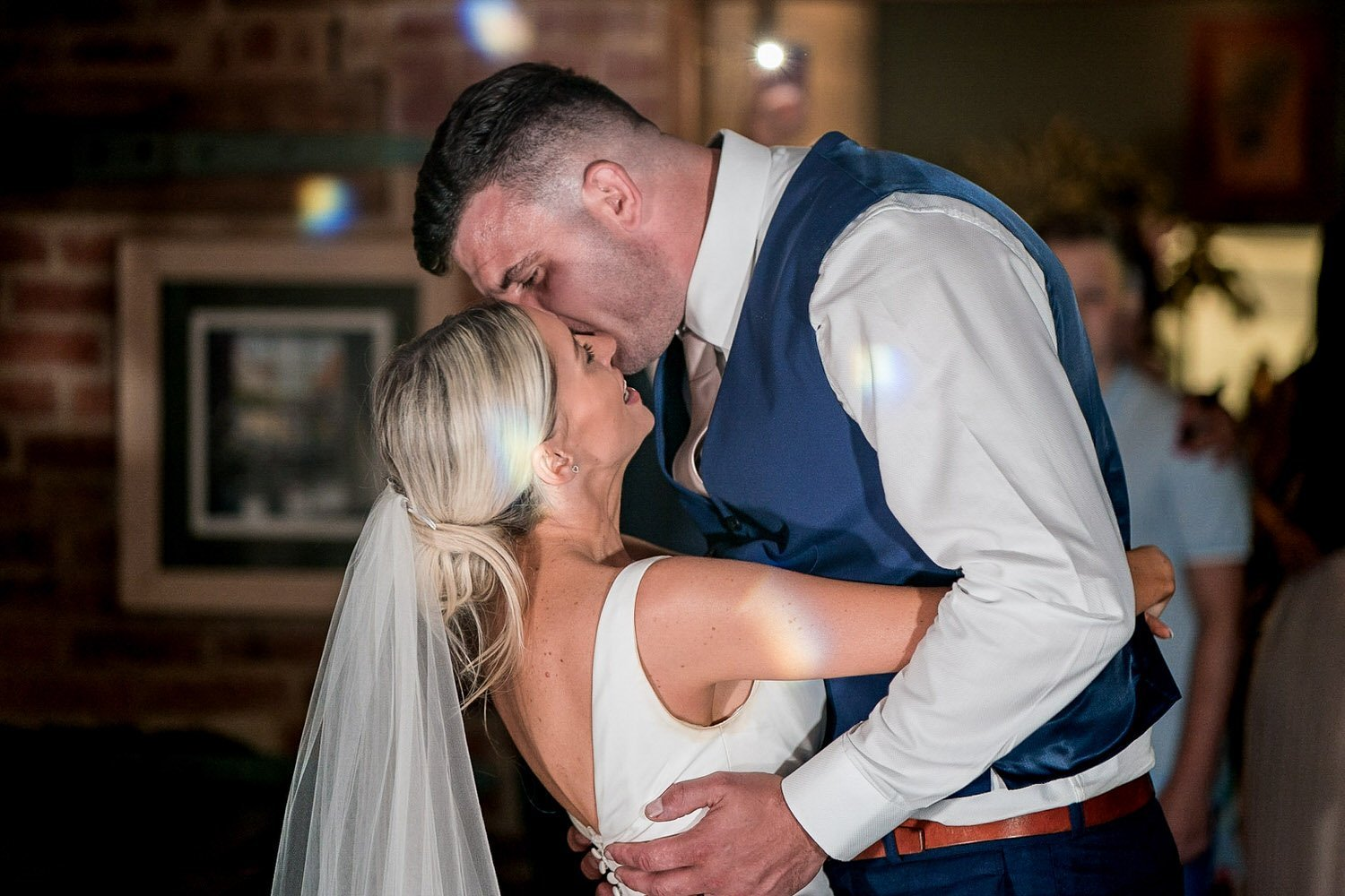 The Waterfront Market Harborough Lockwood Weddings Photography groom cuddling his wife bride during first dance