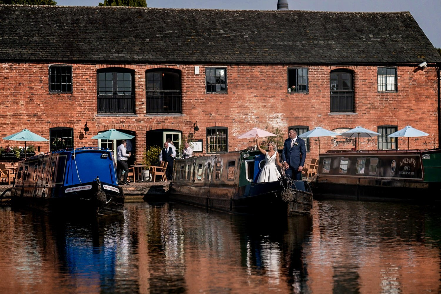 The Waterfront Market Harborough Weddings Photography Bride and Groom on a barge front waving at their family