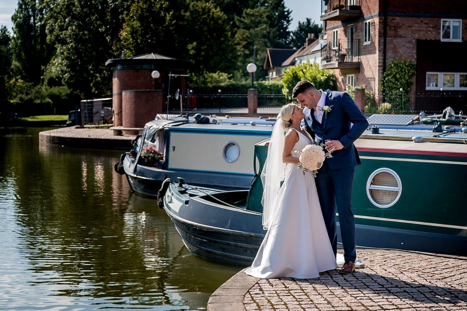 The Waterfront Market Harborough Weddings Photography Bride and Groom on the tow path in front of the barges