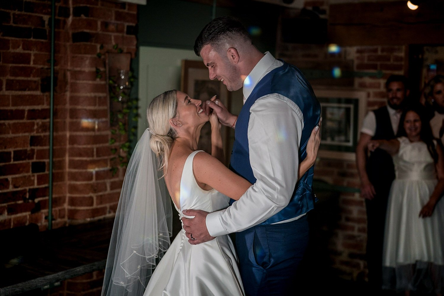 The Waterfront Market Harborough Weddings Photography groom and bride dancing during first dance hand in hand