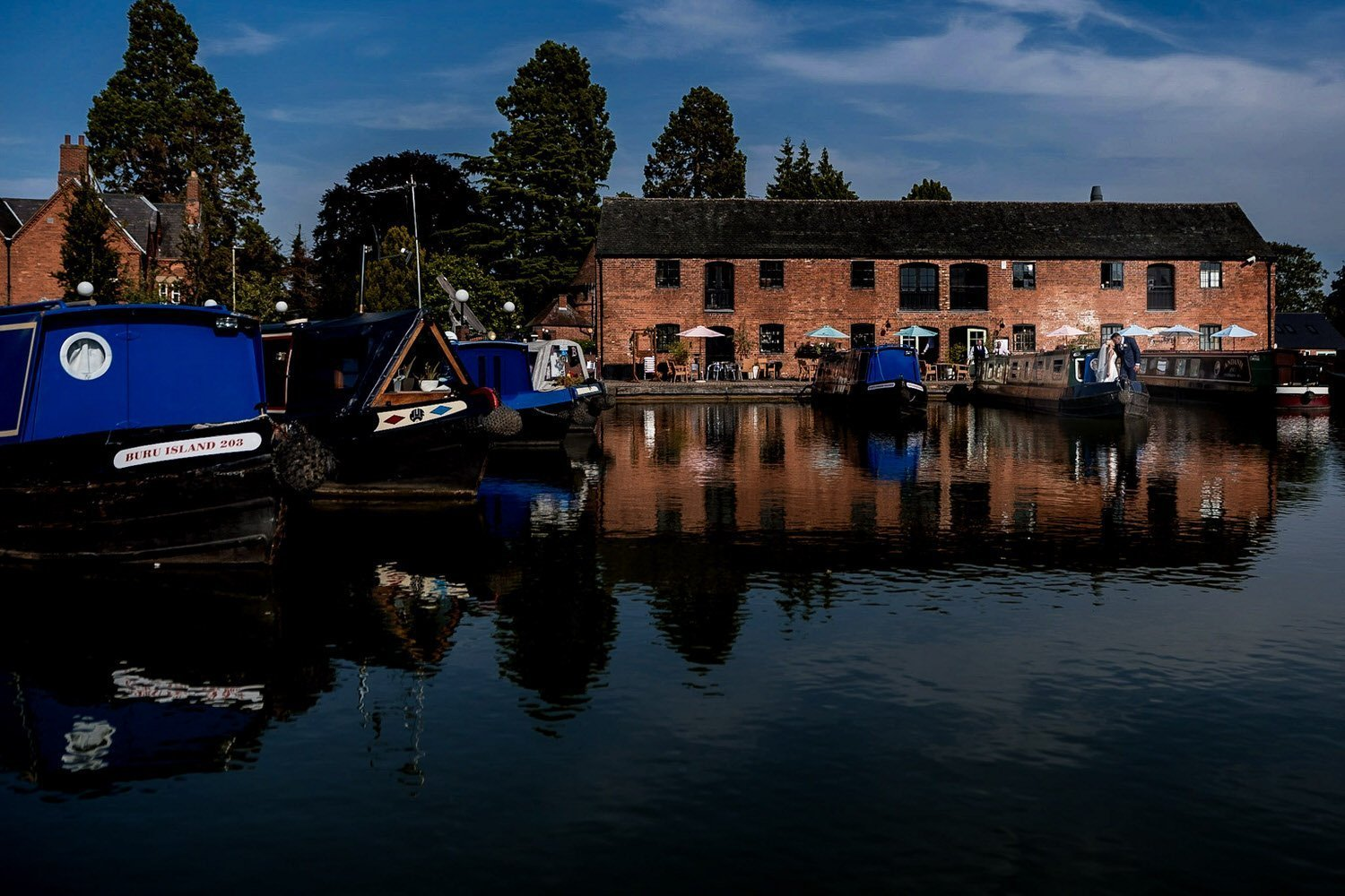 The Waterfront Market Harborough Weddings Photography groom and bride on a canal barge with the whole canal basin in view