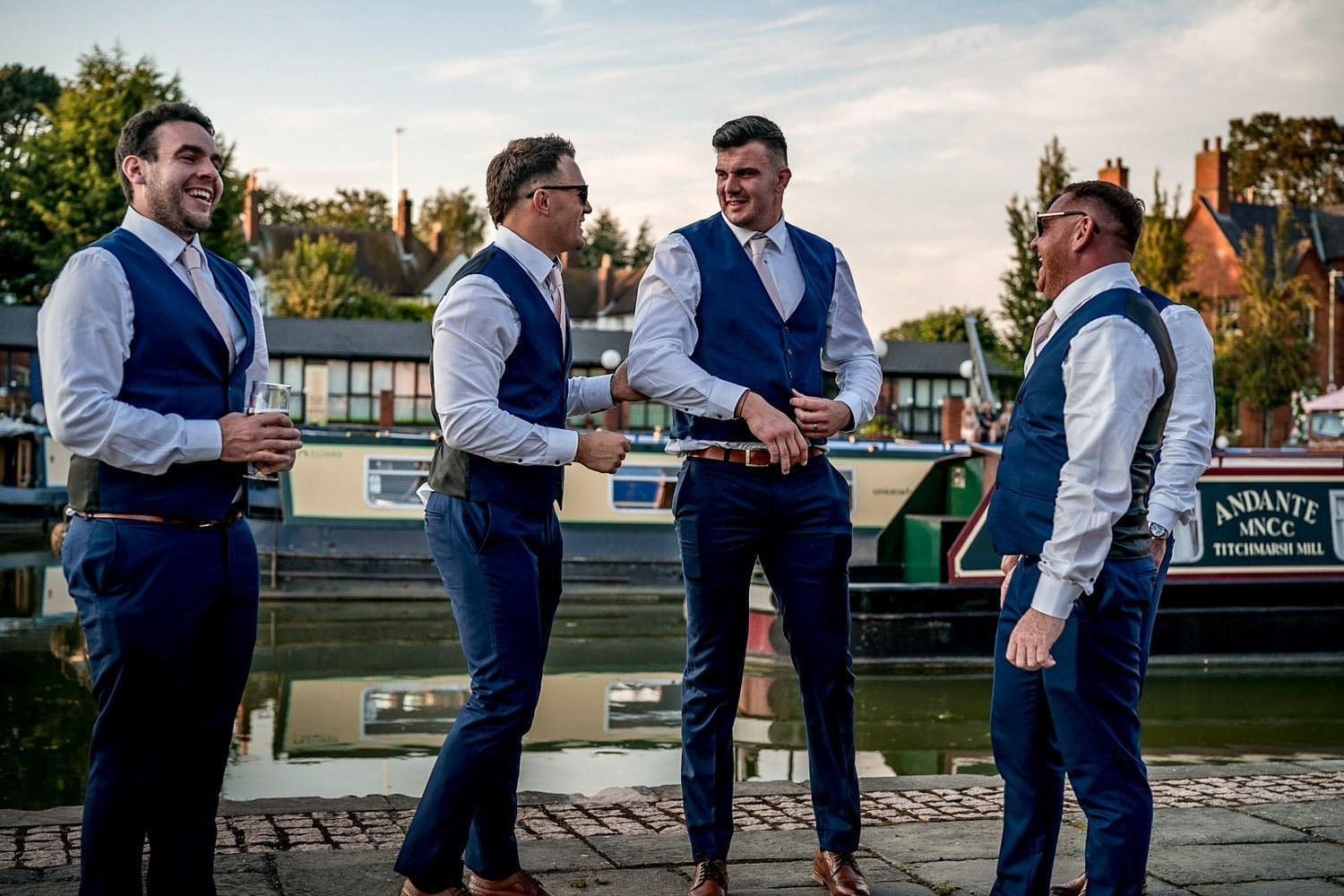 The Waterfront Market Harborough Weddings Photography groom and his ushers on the tow path with the canal barges floating behind