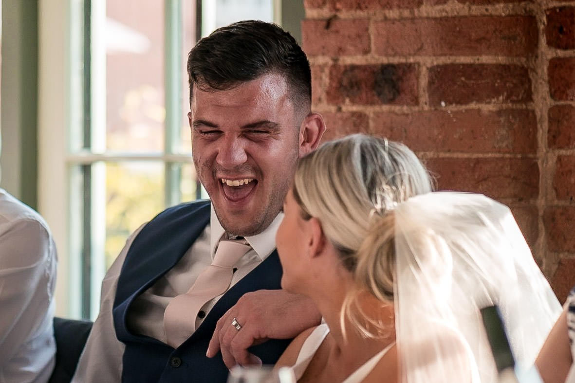 The Waterfront Market Harborough Weddings Photography groom laughing heavily during speeches
