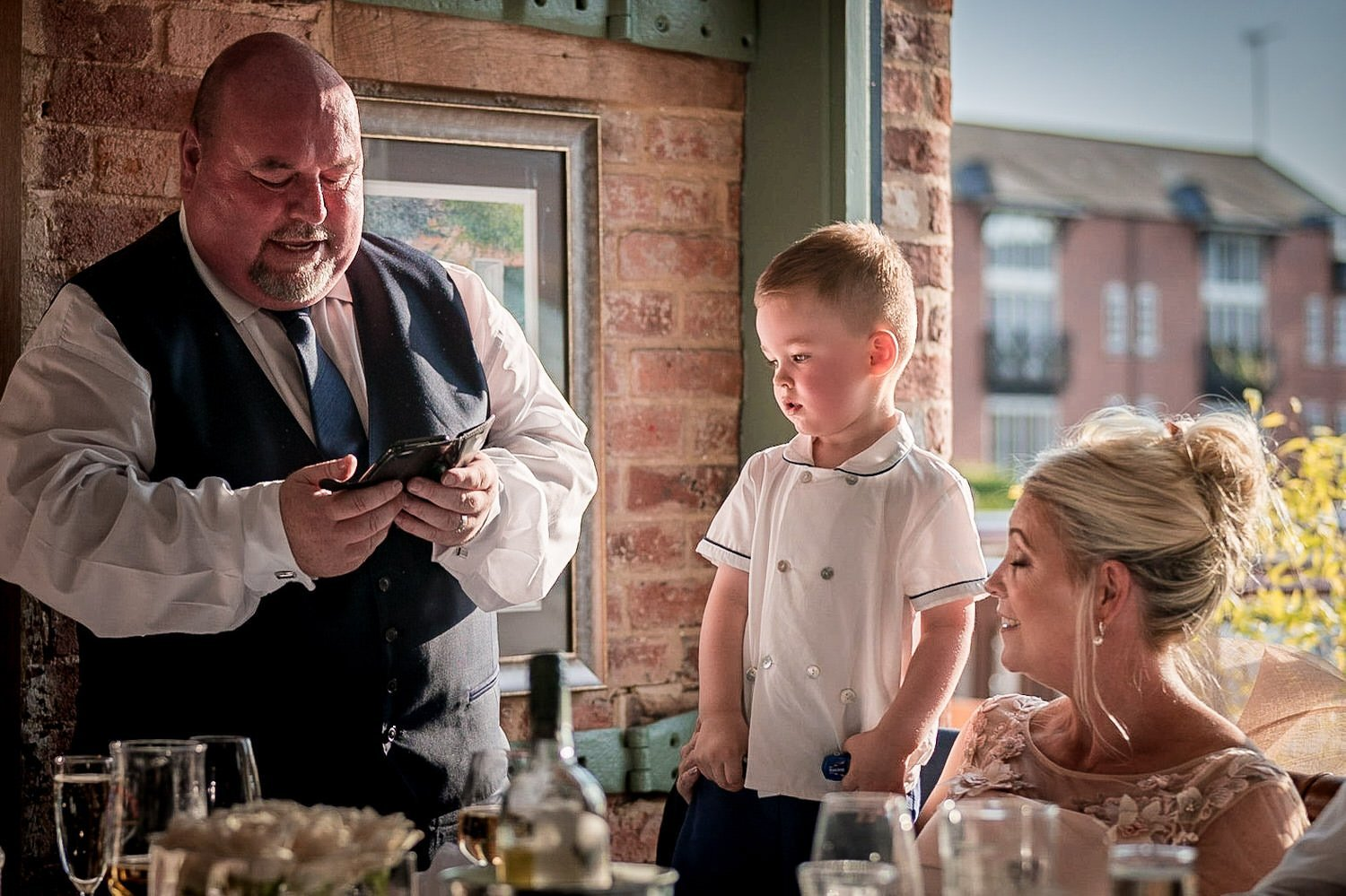 The Waterfront Market Harborough Weddings Photography step father of the bride giving a speech for his grandson who is looking on slightly confused
